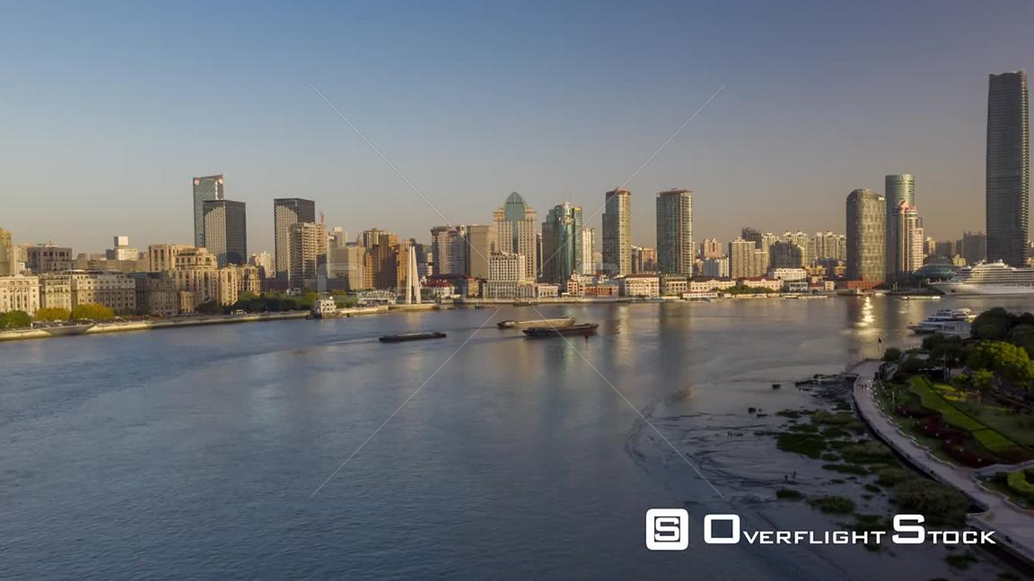 China Shanghai Aerial Hyperlapse flying low over Huangpu river with boats toward Waibaidu bridge