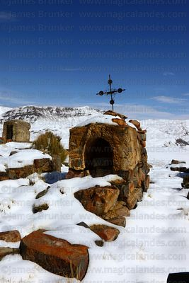 Tombs in Milluni cemetery after winter snowfall, Cordillera Real, Bolivia