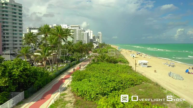 Aerial drone hyper lapse Miami Beach Atlantic Greenway bike riding 4k