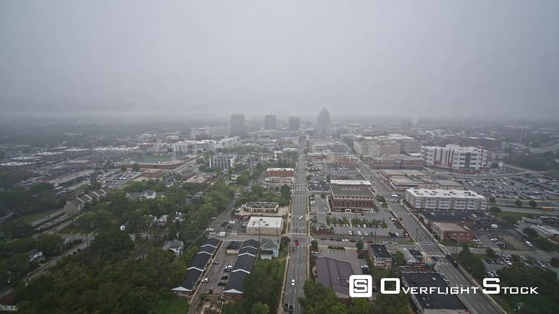 North Carolina Greensboro Aerial Birdseye view of cityscape traffic in reverse with fog