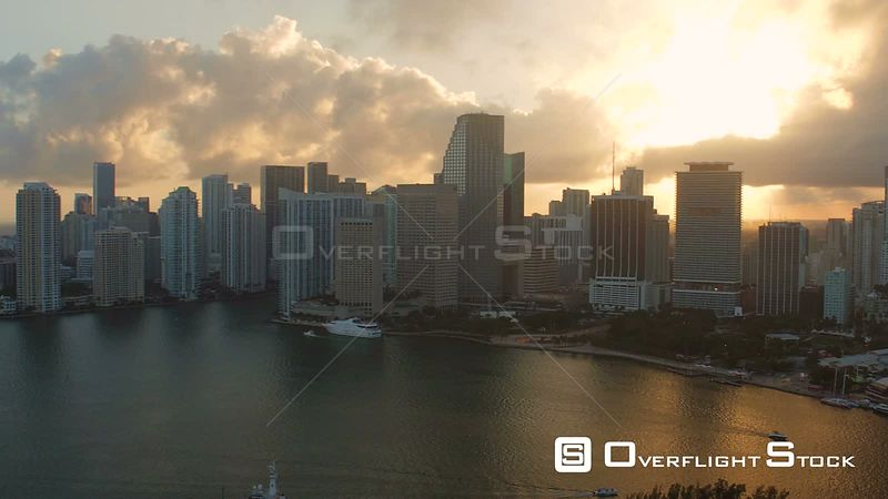 Miami Florida Flying over bay panning with cityscape views at sunset.