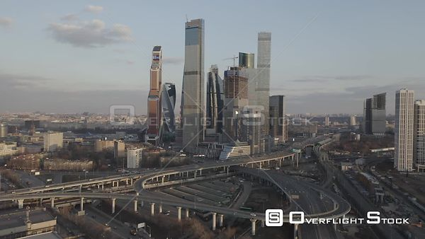 Early Sunset Flight Towards the Moscow With Business City Center and Spaghetti Junction. Moscow Russia Drone Video View