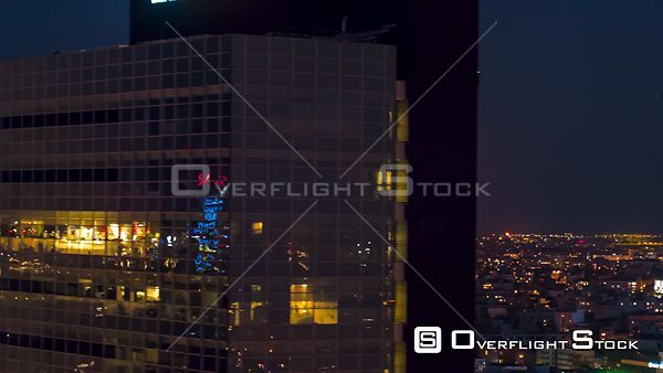 Aerial view of a full moon and an office building, filmed by drone, at night, Bucharest, Romania