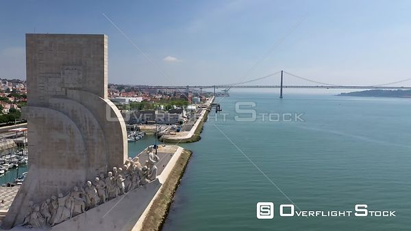 Aerial tracking of Monument to the Discoveries,revealing 25 of April bridge in Belém, Lisbon, empty streets During Covid-19 P...