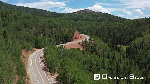 Winding highway in tree covered mountains, Teller County, Colorado, USA