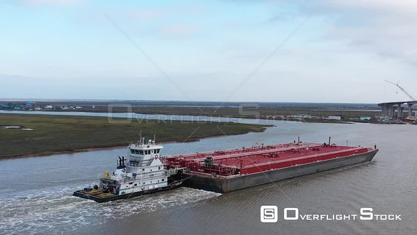Petroleum Barge and Tow Approaching a Bridge, Sargent, Texas, USA