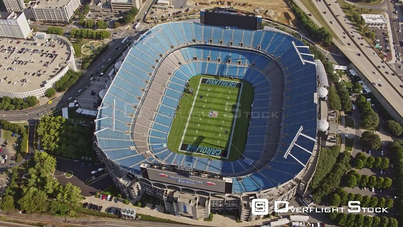North Carolina Charlotte Aerial Vertical panning to birdseye view of Bank of America Stadium