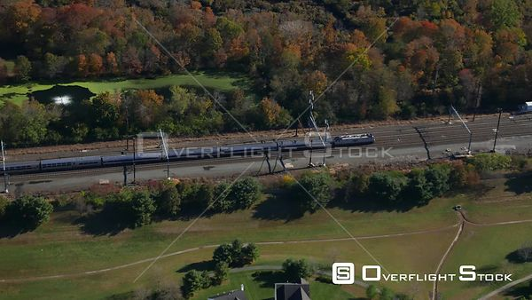 Amtrak Passenger Train Speeding through New Jersey Countryside in Autumn