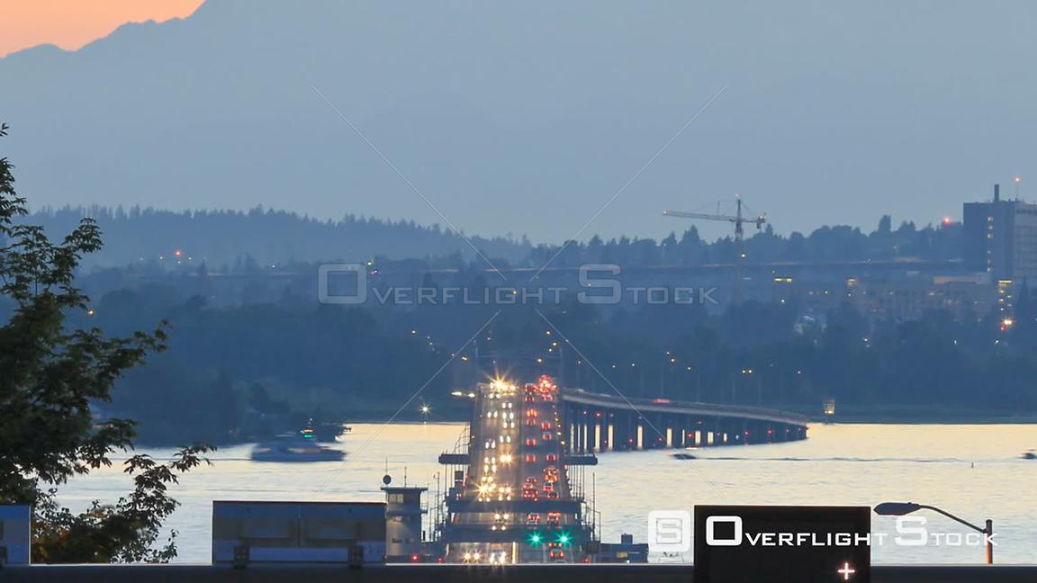 Seattle Washington State USA Panning clip of Seattle highway 520 traffic time lapse right after sunset with cars coming and g...