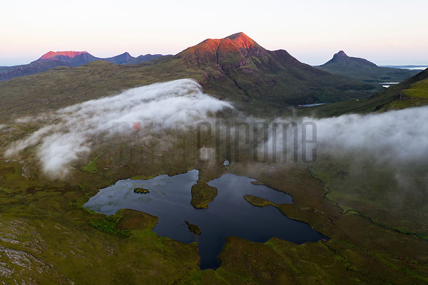 First Light on Cul Beag, Stac Pollaidh(right) & Ben More Coigach (left) with Loch nan Ealachan in the Foreground