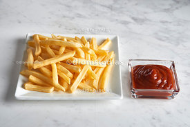 Square modern dish with fries and ketchup pot