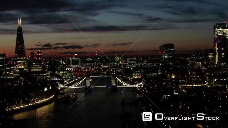 City of London Skyline and Tower Bridge, filmed by drone in autumn, at dusk, London, United Kingdom