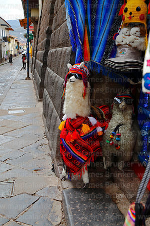 Toy llamas wearing shades in entrance of souvenir shop, Cusco, Peru