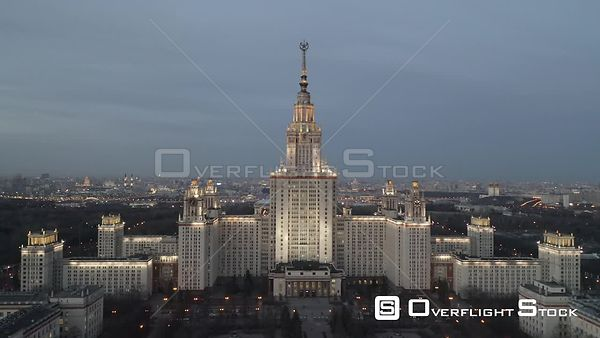 Dusk Approach Towards Moscow State University With City Lights. Moscow Russia Drone Video View