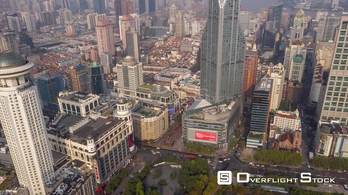 China Shanghai Aerial Hyperlapse birdseye view of riverfront area from high to low
