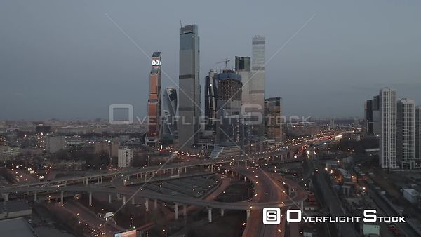 Dusk Flight Towards the Moscow With Business City Center and Spaghetti Junction, With City Lights. Moscow Russia Drone Video ...