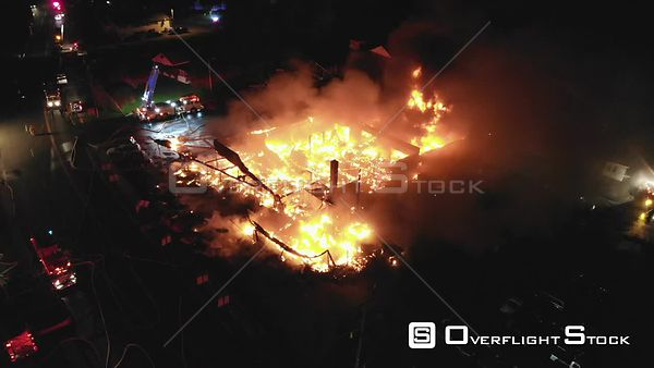 Large Commercial Mall Fire and Oil Drum Explosions Ellenville New York Drone View