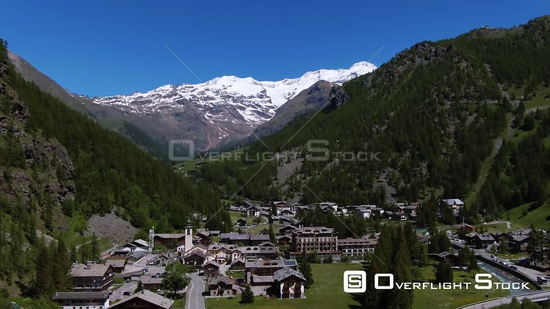 Aerial view of the sky resort village of Gressoney la Trinite in the Italian Alps, with Mount Rosa in the background