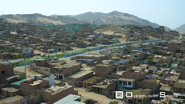 Ventanilla  Peru  Flying low over urban poverty hillside housing area.
