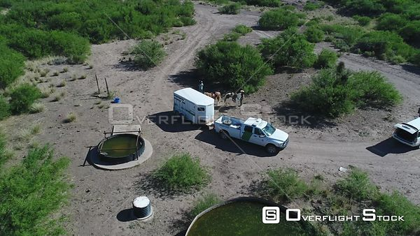 East of Douglas At Hay Hollow Wash Water Hole. Border Patrol Truck and Horses. Arizona