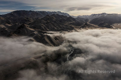 Aerial Landscape Short After Autumn Sunrise Over the Kurmduk Valley in the Vicinity of the Ak-sai Valley and Kol Suu Lake, Sh...