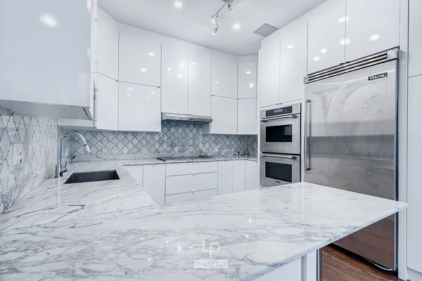 Nice and modern white kitchen with marble