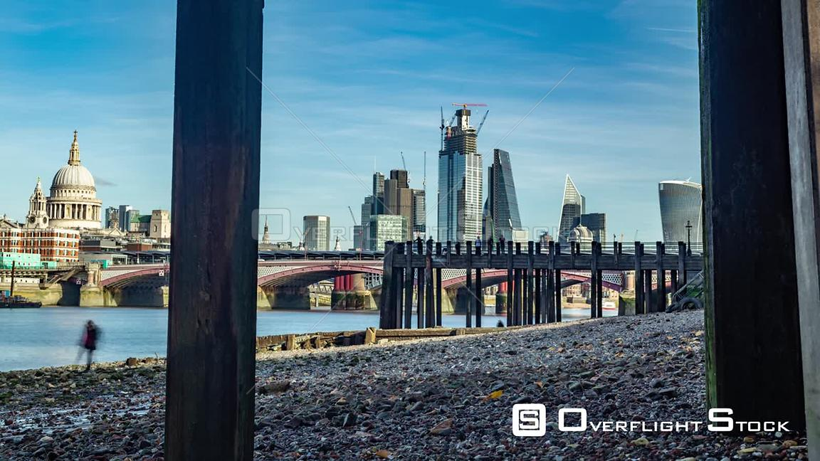 Timelapse view of the skyline of the City of London framed across the river Thames