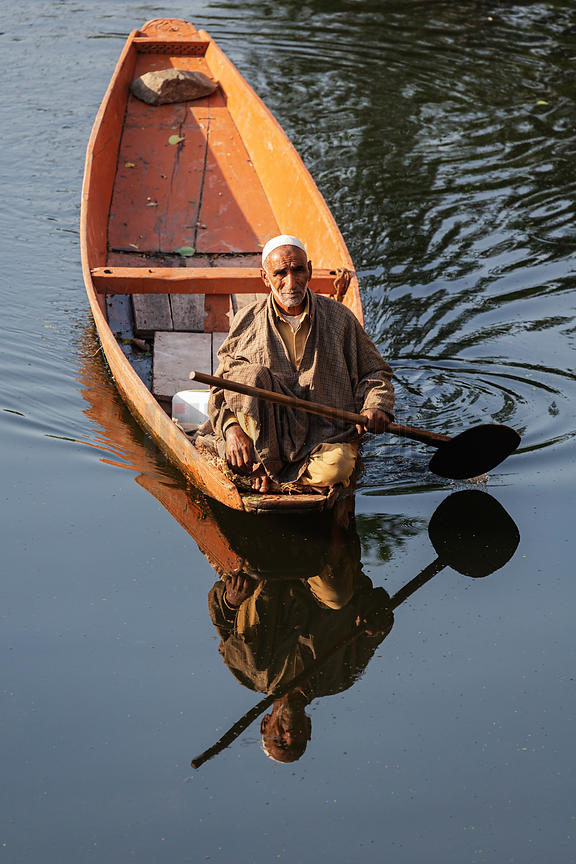 Man Paddling Flat-bottomed Canoe on Dal Lake
