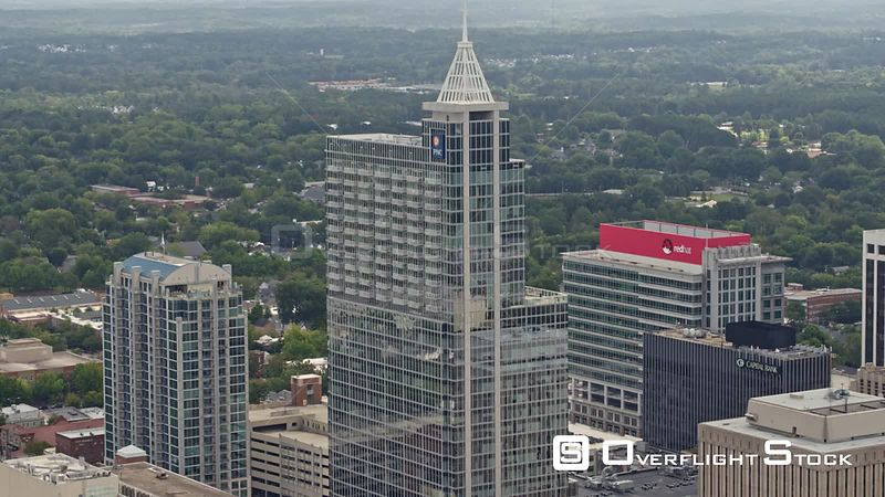 North Carolina Raleigh Aerial Slowly panning around downtown tall buildings