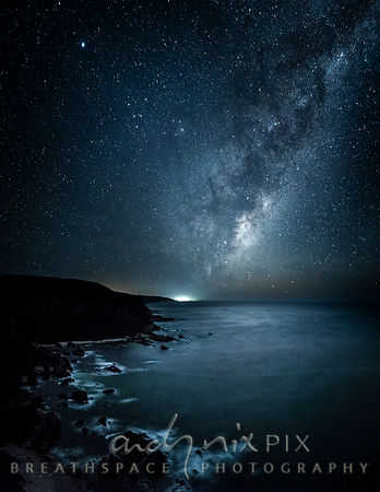 Milky Way galaxy and stars rising over the sea at night