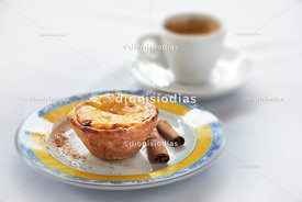 Belem pastel on a plate with cup in the background
