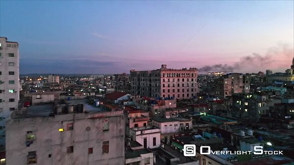 Cuba Havana Flying low over Old Havana neighborhood with rooftop cityscape view at dusk