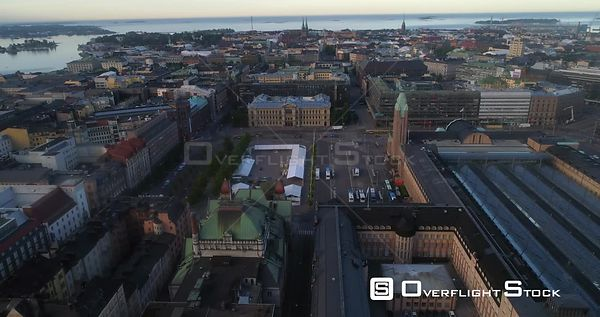 City Railway Station, Aerial Descending Tilt View Helsinki TraStation, Sunny Summer Morning Dawn, Helsingfors, Uusimaa, Finland