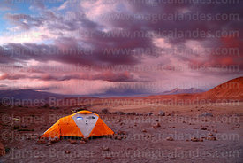 Base camp for Guallatiri volcano and stormy sky at sunset, Lauca National Park, Region XV, Chile