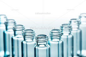 Vials for the biological sample on a white background aligned with V.