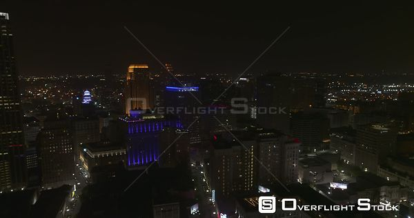 New Orleans Louisiana Aerial Flying above nighttime downtown cityscape