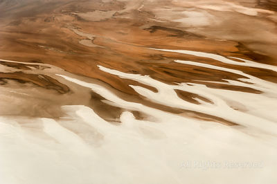 Beautiful Abstract Landscape Image Taken from Airplane Window Above the Salar De Uyuni During Sunrise, Serving as a Great Nat...