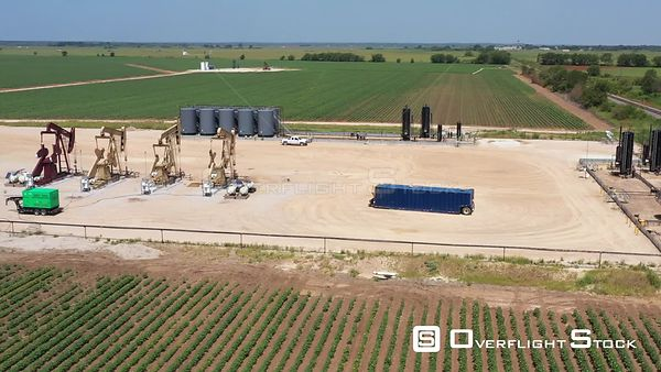 Petroleum pad site with pump jacks working, Brazos County, Texas, USA