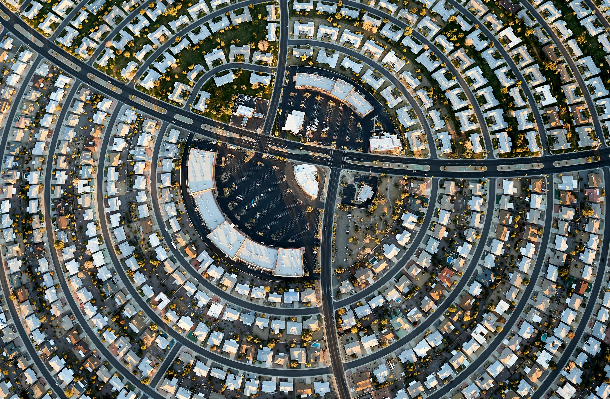 Aerial of suburban homes and patterns in Sun City, Arizona.