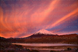 Fiery sunset over Parinacota volcano and lagoon, Lauca National Park, Region XV, Chile