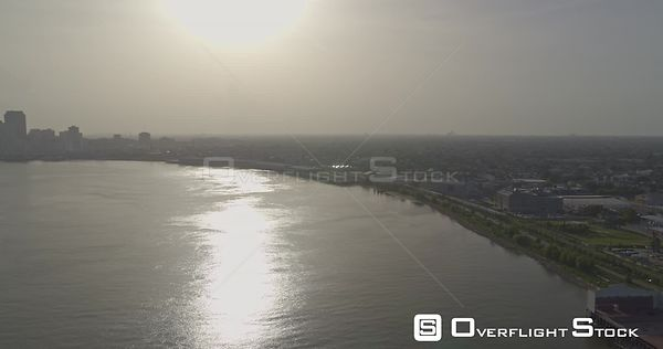 New Orleans Louisiana Aerial Traveling panoramic view of downtown & Algiers Points flying over river