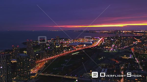 Toronto Ontario Fast sweeping reverse panoramic over Niagara CityPlace sunset dusk cityscape