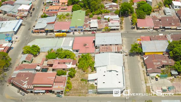 Flying low over Palmar Norte town panning looking down. Costa Rica