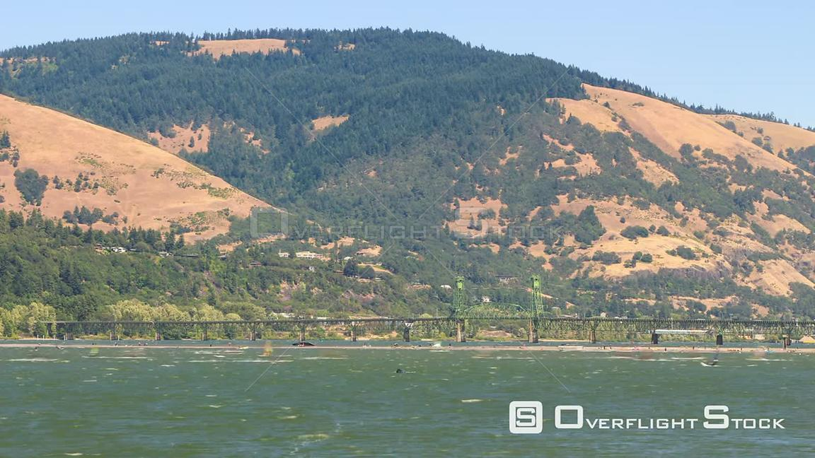 Time lapse of lots of kite boarders and windsurfers on the Columbia River. Oregon