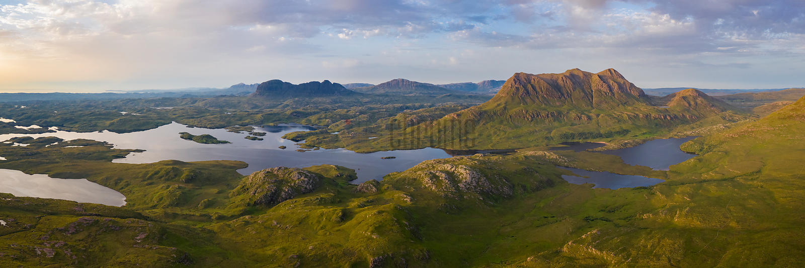 View from Stac Pollaidh looking north towards Suilven (the darker peak to the left—the larger peak on the right is Cul Mor)