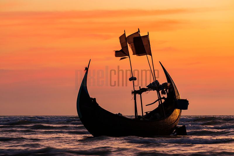 Traditional Crescent Boat at Sunset
