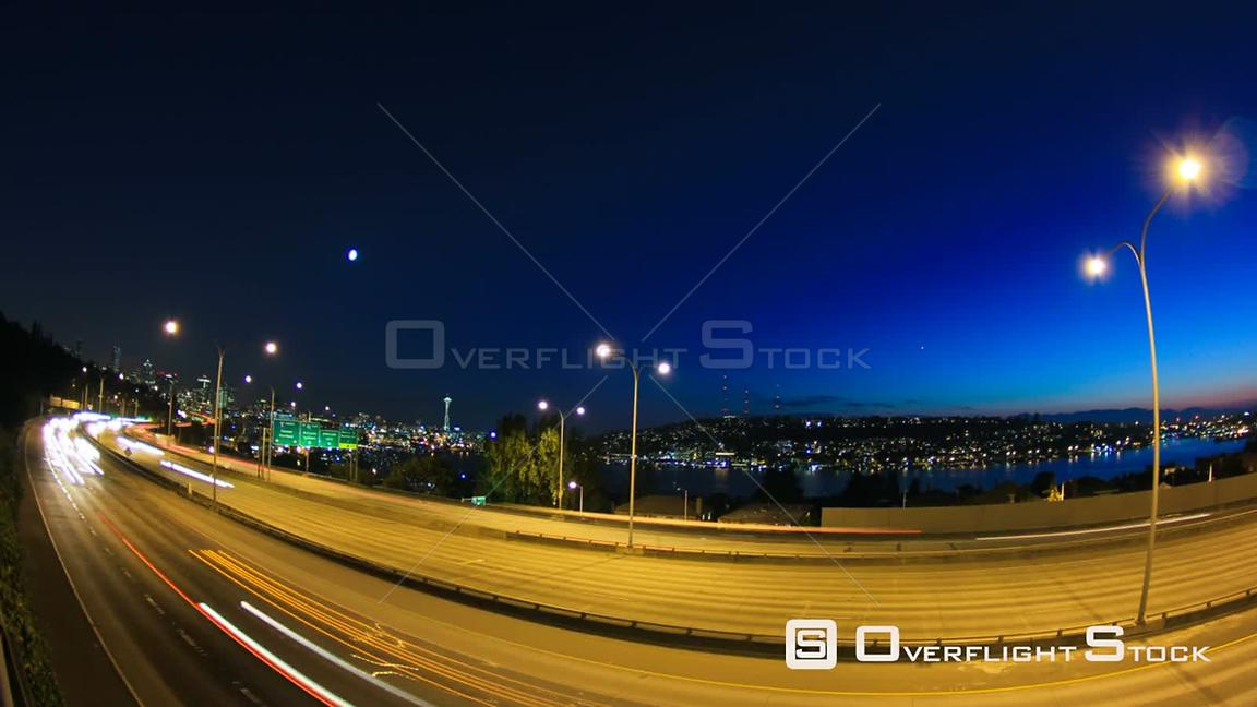 Seattle Washington State USA Seattle I5 time lapse with cityscape in background at duskFisheye lens used.