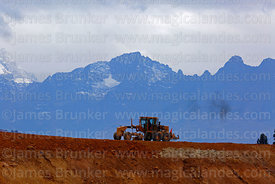 Road grader working moving earth at the site of the planned new international airport for Cusco and Machu Picchu, Chinchero, ...