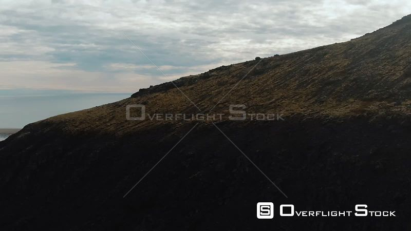 A Volcanic Mountain Revealing a Sandy Beach in West Iceland