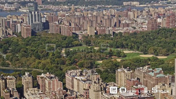 NYC New York Panning birdseye of Central Park cityscape near reservoir with museum